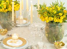 Passover-Perfect Spring-Inspired Table Setting: Alongside the traditional symbolic items, pull out all the stops with this elegant, festive, and spring-inspired scene of golds and creams, flickering light, buttercup ranunculus