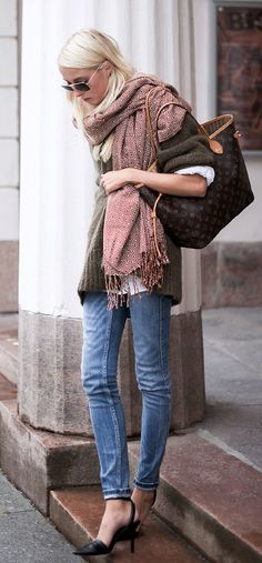 Ellen Claesson is wearing a knit jumper from Acne Studios, jeans from Zara, scarf from Weekday, shoes from Alexander Wang and the bag is from louis Vouitton