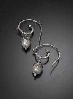 Sterling silver and Pearl Earrings Hand textured sterling silver and pearl earrings by Linda Reyes-Alicea