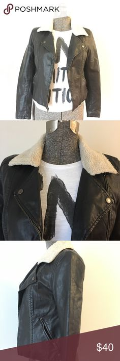 """Sparkle & Fade Faux Leather Moto Jacket Sparkle & Fade Faux Leather Moto Style Jacket With Faux Shearling Collar. Size Small. 100% Polyurethane/100% Cotton. Sleeve about 24 1/4"""", Length about 20.5"""", Underarm to Underarm 16.5"""". Zippered Closure, Two Welt Pockets. Worn Lightly. Great Look For A Lot Less! Sparkle & Fade Jackets & Coats"""