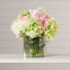 Features: -Made with faux silk. -Vase made of glass. -Pink color. -Assembled in the USA, Made in China. -Exclusively Ours. Product Type: -Floral Arrangements. Color: -Pink and Green. Size: -Me