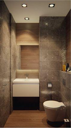 petit salle de bain au revetement type granit avec grand lavabo moderne et meuble WC en forme conique