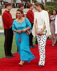 (L) HRH Princess Haya Bint Al Hussein walks down the red carpet with actress Olivia Palermo on the final day of the Cartier International Dubai Polo Challenge 10th edition at Desert Palm Hotel on 21.02.2015 in Dubai, UAE.