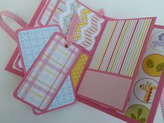 This Scrapbook Mini Album is perfect for girls to journal and add photos! It also makes a unique baby girl shower gift brag book!    The album measures 5.75 X 4 inches. It has sturdy chipboard covers and its pages are hinged. It closes with a pink grosgrain ribbon tied in a bow. Inside the album features 8 page surfaces to add photos, with 5 pockets and 7 removable tags. Use double sided tape to add your photos or add photo corners.    This mini album is ready to ship! Its created by me with…