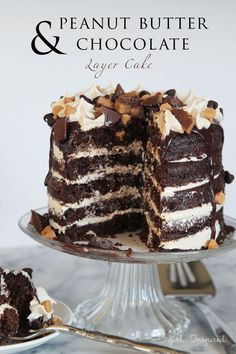 Peanut Butter Chocolate Layer Cake Recipe - a peanut butter lover's dream cake! Layers of fluffy chocolate cake, creamy peanut butter buttercream, and rich chocolate ganache!