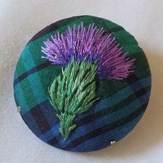 Margaret Dier EmbroideryThursday, 1 May 2014  Silk shaded thistle brooch. This little thistle was embroidered on a beautiful Campbell tartan silk. I used stranded cottons but felt they needed highlighting as the tartan was quite dark so I added some metallic thread stitches.