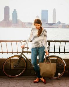 This travel look we spotted on A Cup of Jo works during any season: a striped tee, skinny jeans, and flats. #Style #Travel
