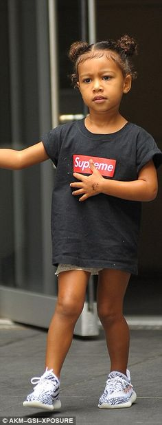 Turning heads: Unfazed by the attention, North cut a cute figure as she headed out into the Big Apple