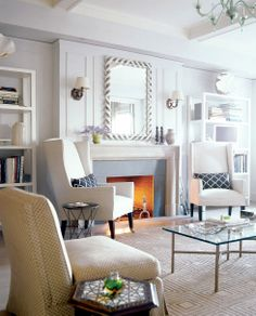 Timothy Whealon -comfortable room, nice vintage ribbon mirror above fireplace