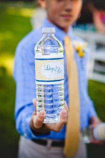 Customized water bottle design with couples logo for guests.
