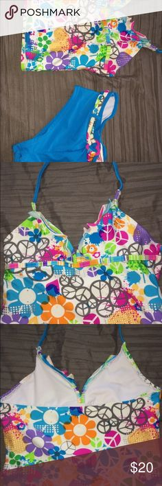 Kids peace love bathing suit This cute bathing suit for girls is a cute, chill and fun day.             It has so many prints on the peaces and a fun belt on the shorts. This bathing suit has never been worn.                                 Delivers only in the U.S.🇱🇷.                                                            Offers and bundles are also available on all of my items. Breaking Waves Swim Bikinis