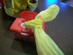 """Step 2 for turning wipes container into plastic bag dispenser . . . put bottom of 2nd bag through the handles of the first bag, and shove it all into the wipes box. Repeat as many times as needed. A new one will pop up when you pull one out. Much more organized than my current """"system."""" =)"""
