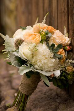 The beautiful bouquet-- wrapped in burlap for an authentically rustic look. {Jennifer Baumann Photography}
