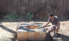 Pour in the final layer and level out | Turn Your Backyard Into A Camping Area With This DIY Outdoor Fire Pit