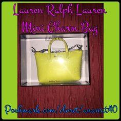 """Lauren Ralph Lauren Mini Charm Bag Lauren Ralph Lauren Mini Charm Bag       Lauren Mini Key Charm Purse Mini top handles Split key ring and strap Top zip closure Lined 4""""W x 3""""H x 1""""D Leather Imported Lauren Ralph Lauren Bags"""