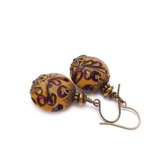 Hey, I found this really awesome Etsy listing at http://www.etsy.com/listing/105327331/mustard-drop-earrings-lampwork-beads