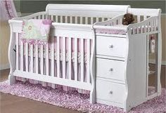 I thought this would be a great crib design for the twins as this design has a little dresser drawer attached as well as a changing table so each girl will have their own 3 drawer dresser for clothes, dypers, blanket  etc. as well as their own changing table. This design helps with storage as well as fits in with the color scheme, design and over all feel of the room.