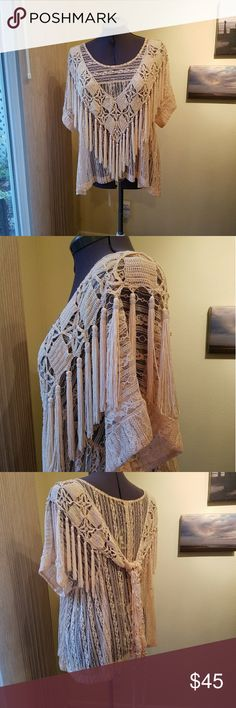 Free People tea lace top with fringe shawl Free People tea lace top with fringe shawl / scarf. In like new condition. Beautiful feminine peach color. Also included is a unique fringe tassel shawl that is the exact same color and when worn together makes a one of a kind top. Shawl is not free people brand. Free People Tops Blouses