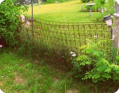 I really like this idea... old mattress springs for a fence.