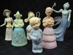 Vintage Avon perfume bottles - I had the yellow one with daisys as a girl. It just got broke the other day :(