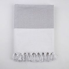 @Overstock - Enjoy fun times on the beach or at the pool with this cotton fouta towel in hand. The towel is made from 100 percent Turkish cotton to provide a soft feel against the skin. It also features a distinctive gray-striped design for a decorative touch.http://www.overstock.com/Bedding-Bath/Turkish-Grey-Stripe-Fouta-Towel/6790264/product.html?CID=214117 $44.99