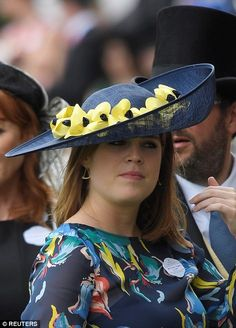 Princess Eugenie's hat picked up on the yellow in her frock...