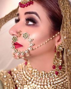 Perfect finishing to a bridal look is given by stunning nose rings! Book the best makeup artist now with BookEventZ to get the perfect bridal look on THE DAY! Nath Bridal, Bridal Nose Ring, Wedding Jewelry, Nose Ring Jewelry, Head Jewelry, Nose Rings, Bridal Makeup Images, Best Bridal Makeup, Black And Silver Eye Makeup