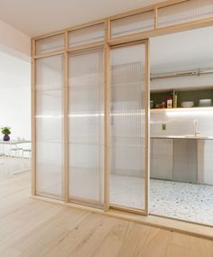 is a minimalist apartment renovation located in Mechelen, Belgium, designed by midnight. Location, orientation and space have been. Architecture Renovation, Architecture Design, Green Architecture, Casa Muji, Kitchen Interior, Interior And Exterior, Design Kitchen, Door Design, House Design