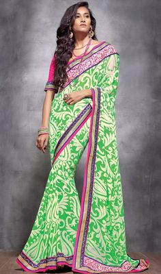 Buttercream and lime green embroidered georgette sari is perfect for evening party requirement. Sari is embellished with all over block print, woven lace and silk thread embroidered border which gives you an grand and exquisite look. Sari comes with contrast pink raw silk stitched blouse as shown in the picture. #PrintedDesignCasualSaree