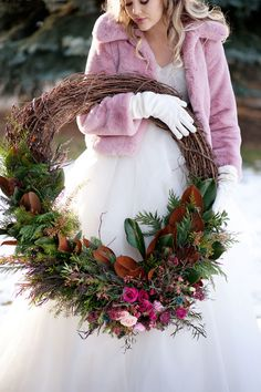 This beautiful winter bride wore a rose coloured faux fur jacket while she carried an oversized grapevine wreath full of fresh magnolia, agonis, cedar, pink ranunculus and pink spray roses. Magnolia Wreath, Winter Wedding Flowers, Pink Faux Fur, Winter Bride, Wedding Wreaths, Christmas Flowers, Spray Roses, Ranunculus, A Boutique