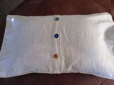 Back of hexie cushion - linen and mismatched vintage buttons