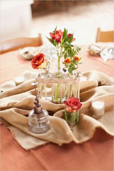 burlap wedding reception table decorations #rusticwedding #diy #weddingchicks http://www.weddingchicks.com/2014/02/07/red-and-orange-fall-wedding/