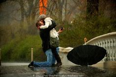 proposing in central park while its pouring rain :]