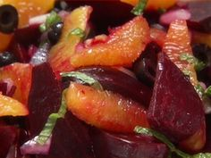 Ingrid Hoffman.  Oranges, lime juice, red onion, mint, olive oil, vinegar and one table spoon of honey.  About 6-8 beets.