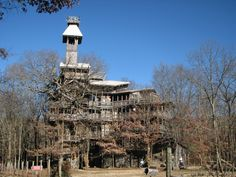 The Minister's Treehouse, Crossville, Tennessee. Horace Burgess began constructing his treehouse over twenty years ago and has been adding to it ever since. Six trees support the structure, the design for which was given to the minister by God.