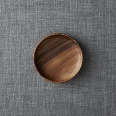 "Shop Tondo 6"" Plate.  Richly grained acacia wood turns out in smooth, sculptural serving essentials, naturally suited to everyday use, entertaining or artful display."