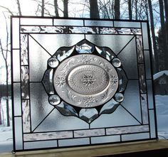 This stained glass panel uses one of my favorite vintage plates as the centerpiece. This oval plate was created in the 1980s reminiscent of