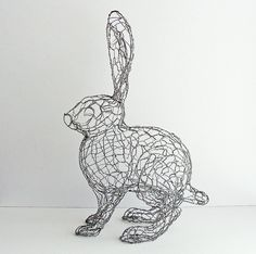 Many jewelry makers use wire to craft their embellished accessories but designer Ruth Jensen extends the malleable material& use beyond necklaces and brac Chicken Wire Art, Chicken Wire Sculpture, Chicken Wire Crafts, Wire Art Sculpture, Rabbit Sculpture, Abstract Sculpture, Wire Sculptures, Bronze Sculpture, Rabbit Wire