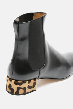Paris-based footwear designer Francesco Russo bypasses the concept of seasonal collections to focus on timeless shapes with a graphic edge. These sleek leather Chelsea boots are accented by heels covered in leopard-print haircalf. Made in Italy, the square-toe style has elasticated gussets and a looped pull tab, ensuring they slip on and off with ease.