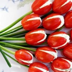 "Tomato tulips. Pretty salad or appetizer idea. Cut tomatoes as shown, scoop out pulp and seeds then fill with your favorite herbed cream cheese, cottage cheese or a creamy salad mixture. Add green onions as ""stems"""