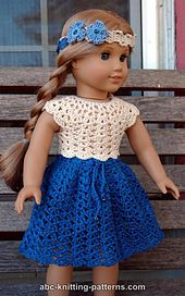This is a free download from Ravelry: American Girl Doll Seashell Summer Top pattern by Elaine Phillips