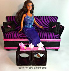 DIY Barbie Doll Couch/Sofa in purple and black zebra print and faux leather accents and coffee table made with up-cycled napkin holders. DIY No Sew Barbie Doll Couch or Sofas and Up-cycled Coffee Table table Play Barbie, Barbie Doll House, Barbie Dolls, Dolls Dolls, Diy Doll Projects, Doll Crafts, Kids Crafts, Barbie Doll Accessories, Dollhouse Accessories