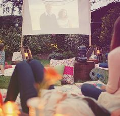 Movie Night. Design Sponge shows us just how easy it is to turn your backyard into an outdoor cinema — all you need is a projector and a wall or sheet.