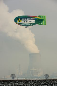 """The Greenpeace airship, flying around Doel Nuclear Power Station. """"Nuclear energy: never safe!"""