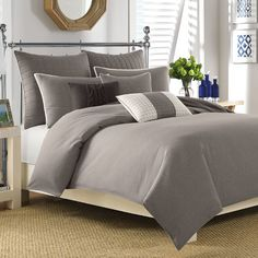 Smooth and serene, this solid comforter set refreshes your master suite or guest room in peaceful style.  Product: 1 Comforter a...