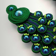 soutache...used as a brooch maybe...with lighter colors