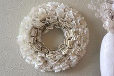 Punch the edges of book pages, fold the pages, and create a wreath! www.fiskars.com