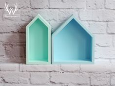 Awesome set of mint and blue house-shaped shelves.