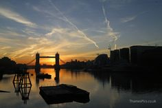 Official sunrise time was 7.20am and about then, the sun began to appear. 16th Nov 2013. Tower Bridge and the River Thames, London