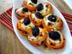 Apricot stuffed with marscapone and blackberry, drizzled with honey, and broiled. Garnished with pistachios.